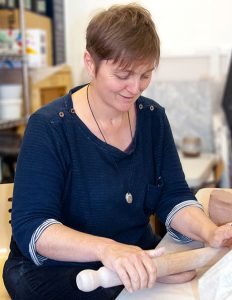 Sarah Core working with clay