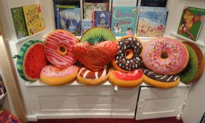 Doughnut and fruit cushions in reading corner